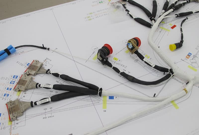Closed Bundle & Overmold Wire Harness Construction | CIA&D on wire harness repair, wire harness fasteners, wire harness tubing, wire harness testing, wire harness connectors, wire harness assembly,